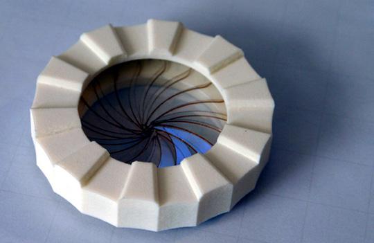Design of a rapid paint ball loaded using an iris valve