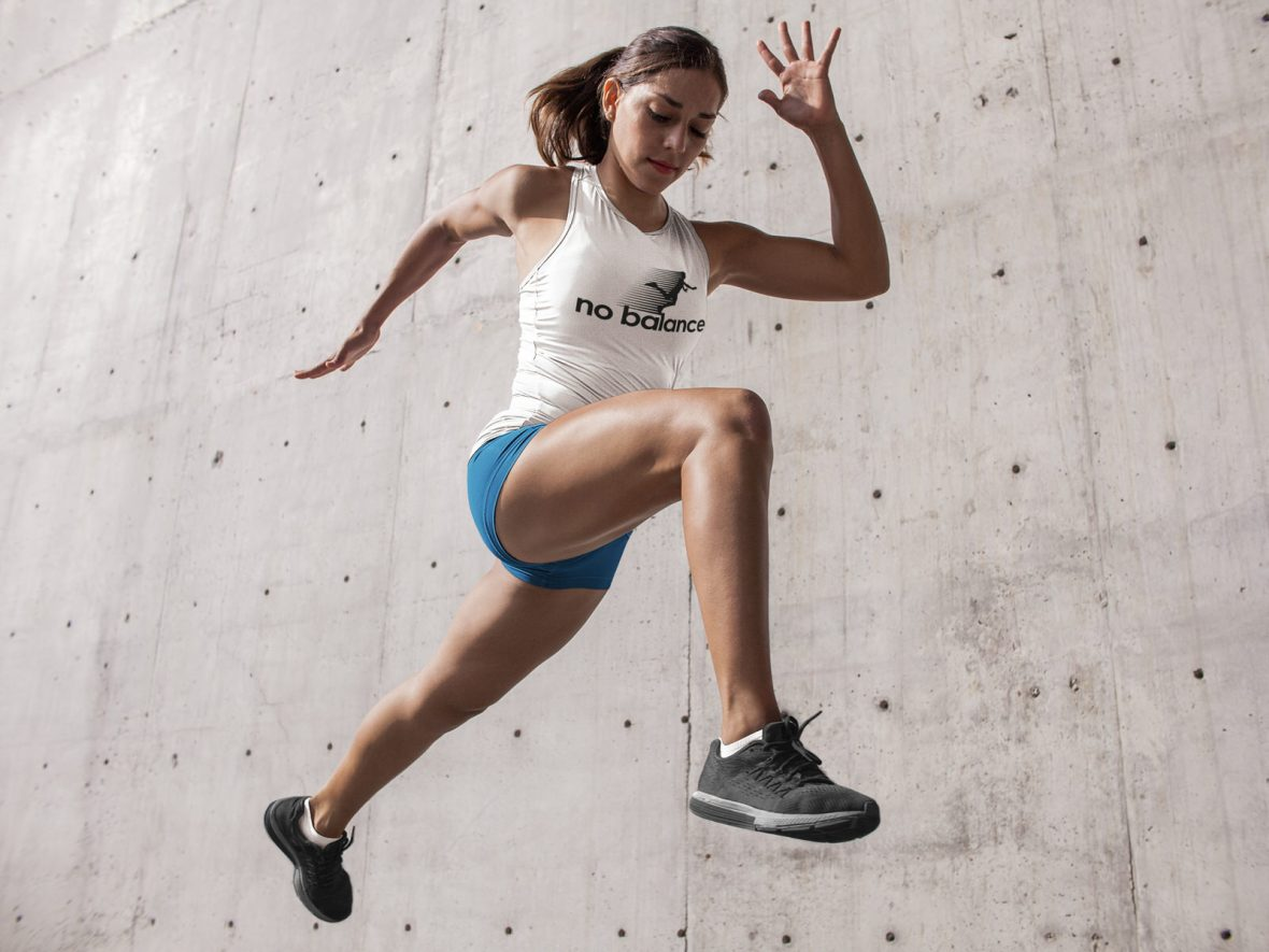 Woman running with No Balance Shirt falling funny