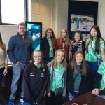 Group photo of green girls at portal instruments on a trip to Boston